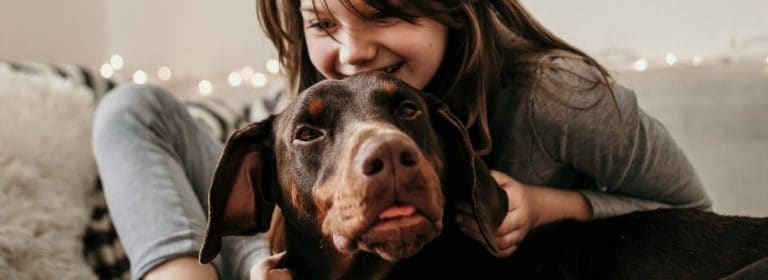 Doberman with Young Girl